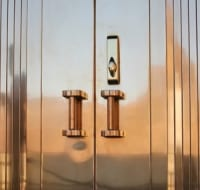 Brass Clad Front Doors with Pleats Houston