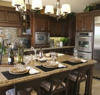 Remodeled Stainless Steel and Stone Serving Island Houston
