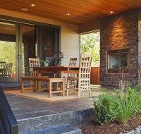 Outdoor Terrace with Wood Ceiling and Stone Fireplace Houston