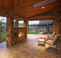Outdoor Loggia with Wood Ceiling and Stained Concrete Houston
